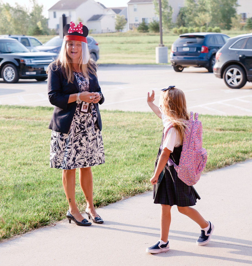 Student waves to principal on first day of school